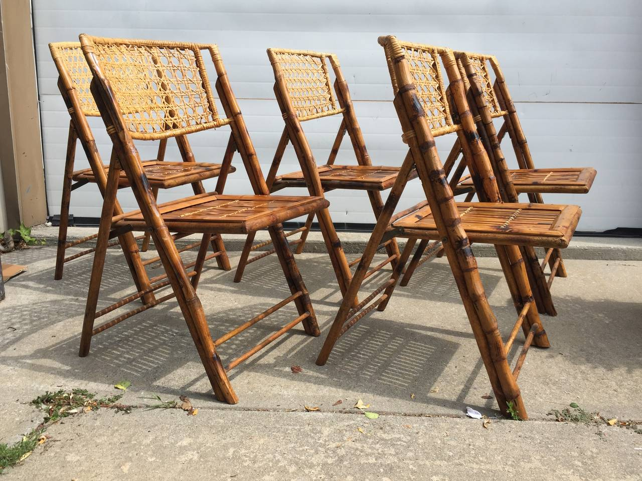 Set Of Five Scorched Bamboo Frame Folding Chairs With Rattan Seat And Back